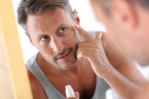 Man using moisturiser