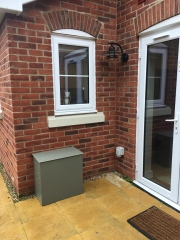 Water softener installed in a weatherproof housing outside a customer's house in Reading.