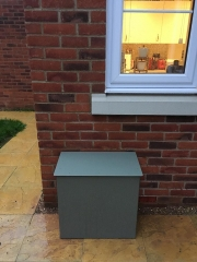 Water softener installed outside a customer's home in Reading.