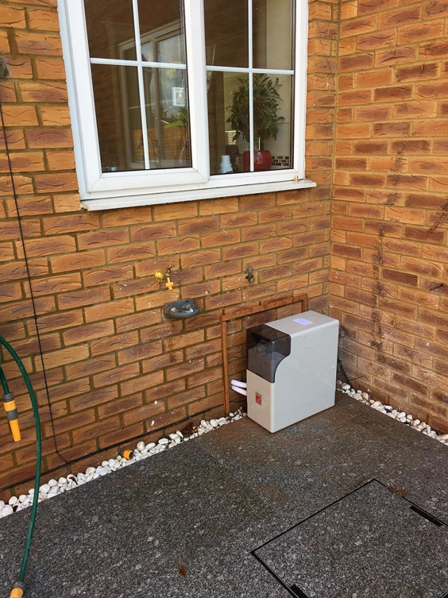 Water softener installed outside a house in Reading