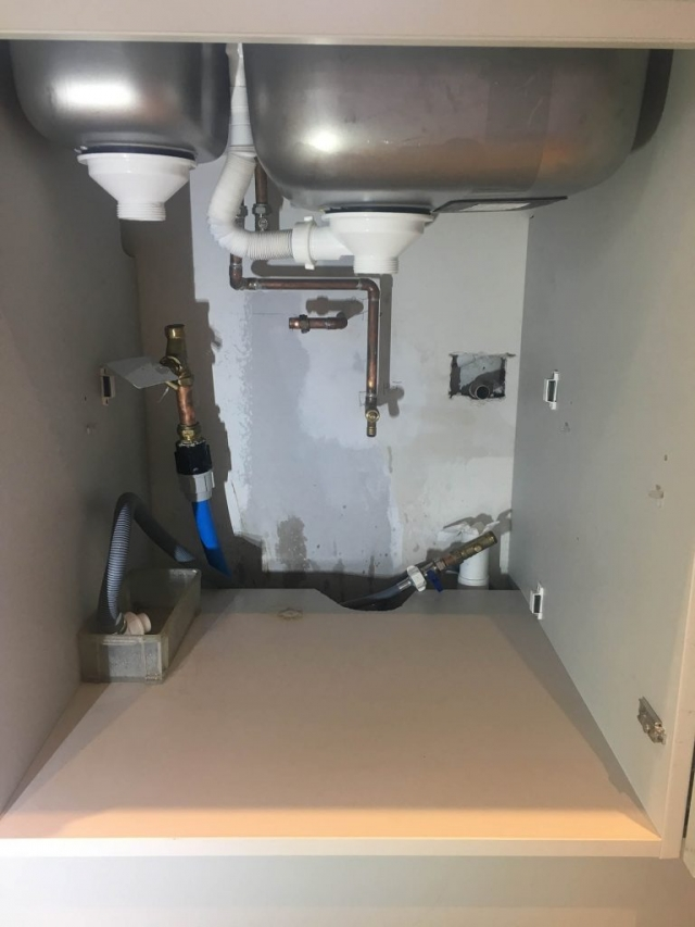 Preparing pipework for fitting a water softener under a sink in Caversham, Reading