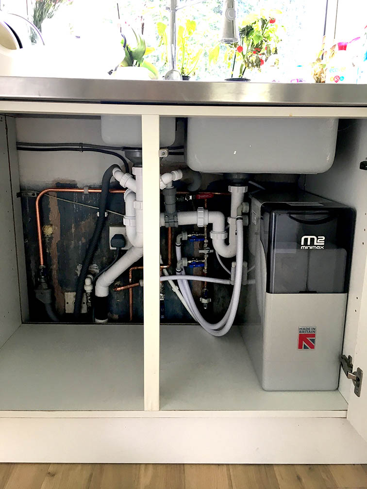 New water softener fitted tidily under the sink in Tilehurst, Reading