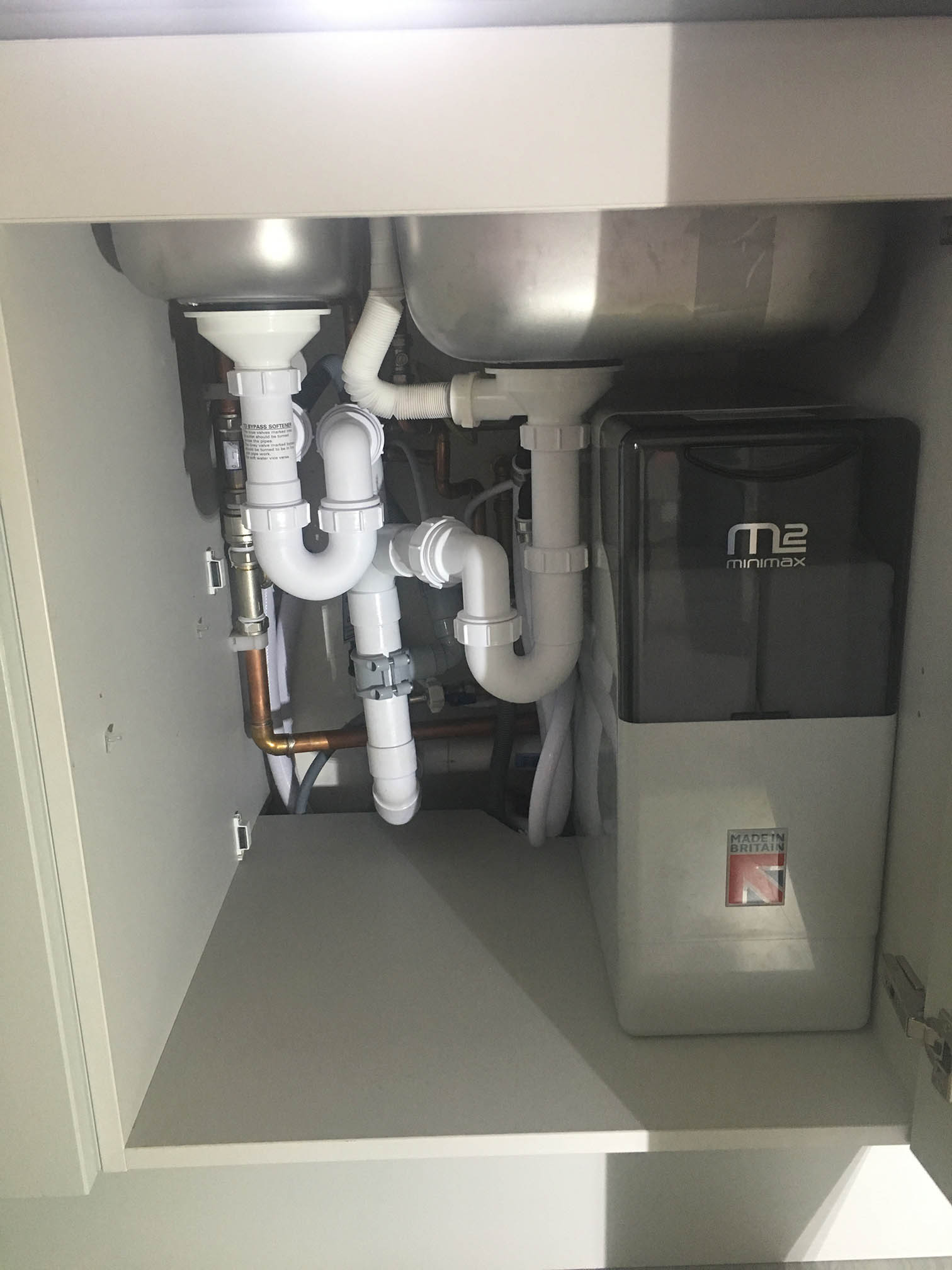 A brand new Minimax water softener neatly fitted into place in Caversham, Reading