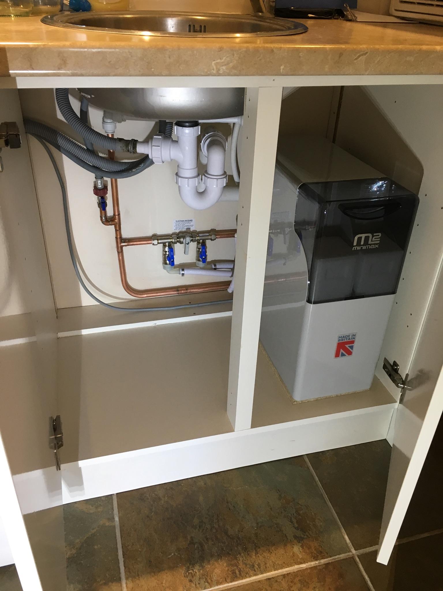 New water softener under kitchen sink