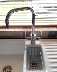 Modern geometric 3 way tap fitted with a water softener