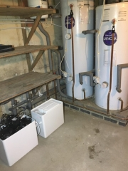 New water softener installed in the basement of an old manor house.